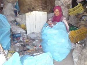 Informal sector, plastic recycling, woman junk shop owner